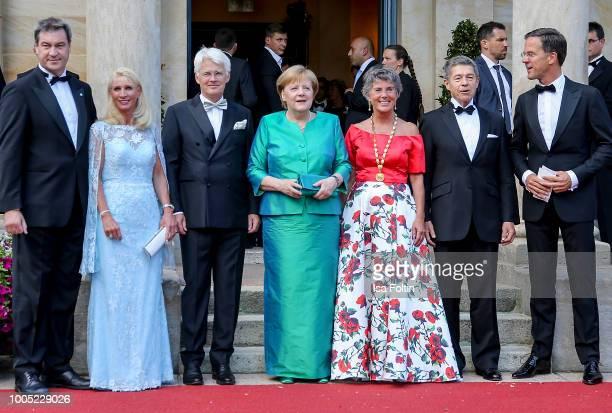 Bavaria's State Premier Markus Soeder poses next to his wife Karin Baumueller, Mayor of Bayreuth Brigitte Merk-Erbe, s husband Thomas Erbe, German...