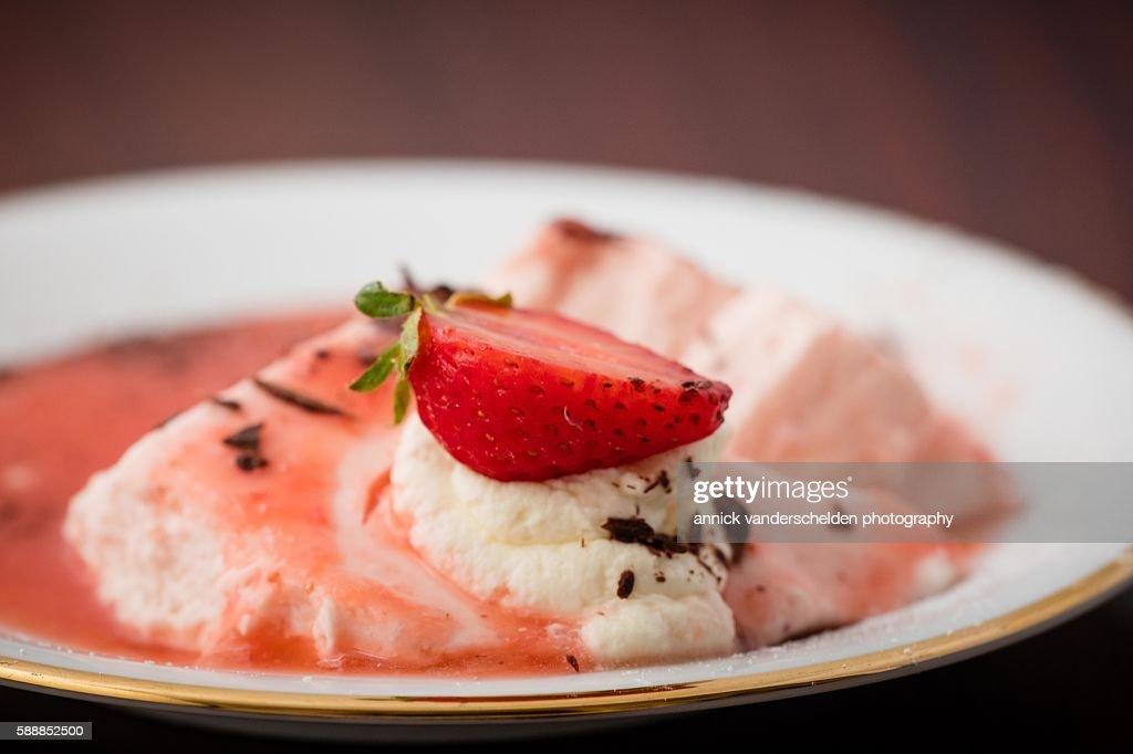 Bavarois with strawberry on white plate. : Stock Photo
