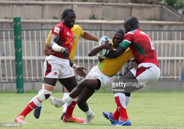 Bavyo Soualio of Ivory Coast challenged by Andrew Amonde of Kenya during the 2019 Rugby Africa Mens 7s match between Ivory Coast and Kenya at the...