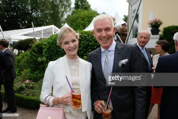 Baxter HP and friend Lysann Geller attend a birthday party for Queen Elizabeth II June 15 2017 in Hamburg Germany