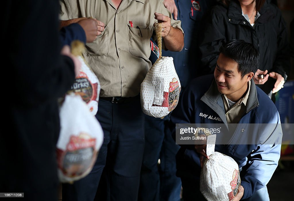 Bay Alarm workers hold donated turkeys at the Bay Area Rescue Mission on November 19, 2012 in Richmond, California. Days ahead of Thanksgiving, the Bay Area Rescue Mission received a donation of 320 turkeys and 60 hams from local business Bay Alarm that will be used to feed a holiday meal to needy and underpriviledged people.