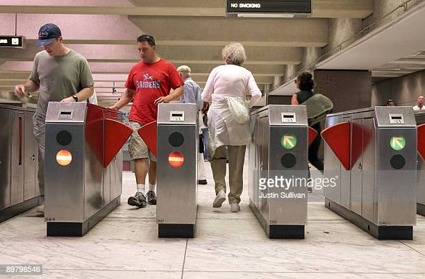 Bay Area Rapid Transit customers pass through a fare gate at the Embarcadero station August 14, 2009 in San Francisco, California. BART train...