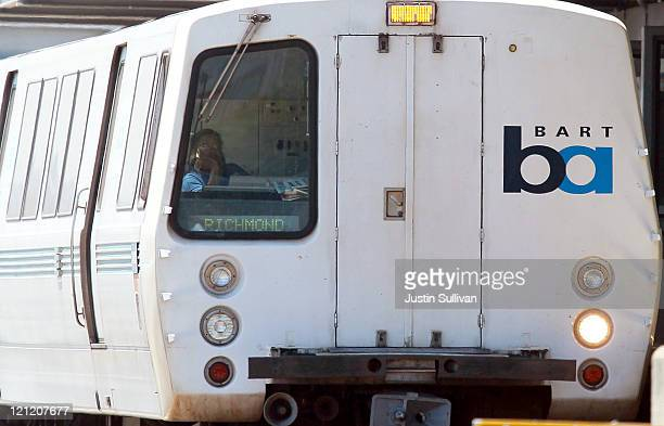 Bay Area Rapid Transit train operator waits for passengers to enter the train at the Daly City station on August 15 2011 in Daly City California The...