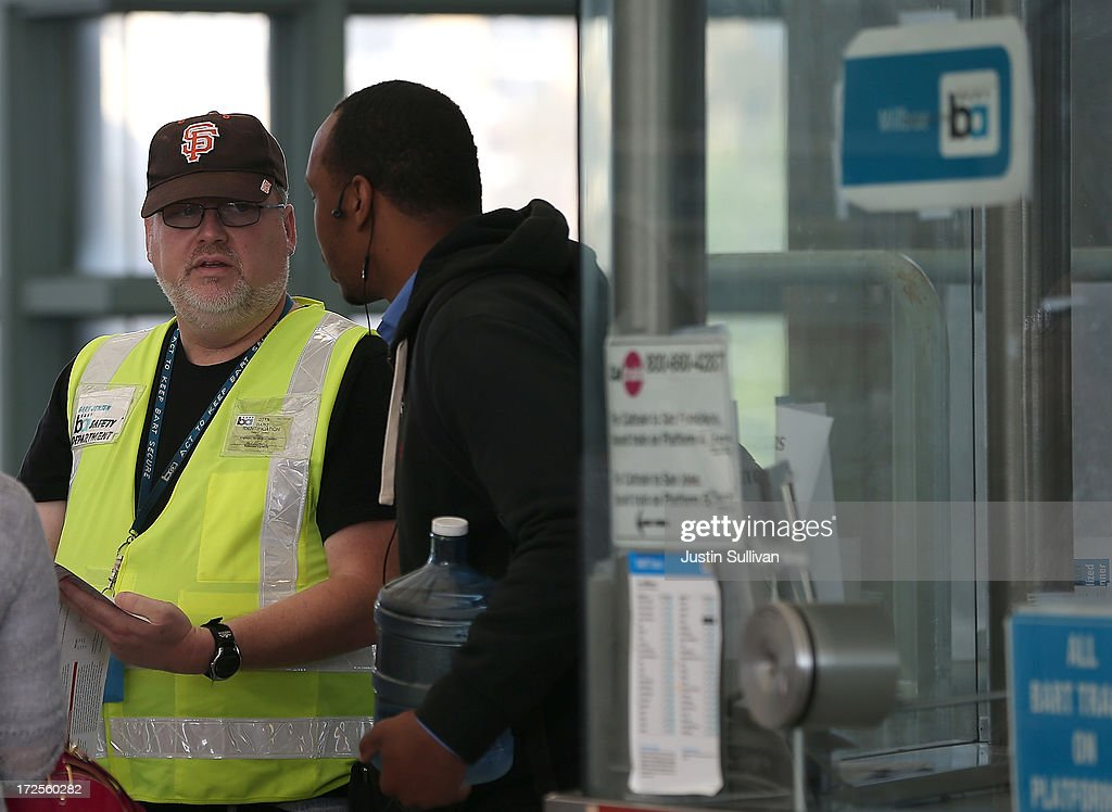 Bay Area Rapid Transit (BART) worker Gary Jensen (L) helps a commuter with directions at the Millbrae station on July 3, 2013 in Millbrae, California. For a third day, hundreds of thousands of San Francisco Bay Area commuters are scrambling to find ways to work as two of San Francisco Bay Area Rapid Transit's (BART) largest unions remain on strike while they continue contract negotiations with management. Train operators, mechanics, station agents and maintenance workers are seeking a five percent wage increase and are fighting management who want to have workers to begin contributing to their pensions, pay more for health insurance and reduce overtime expenses.