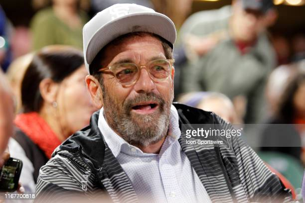Bay Area resident and Grammy winning musician Huey Lewis chats with fans during a break in the game between the Pittsburgh Pirates and San Francisco...