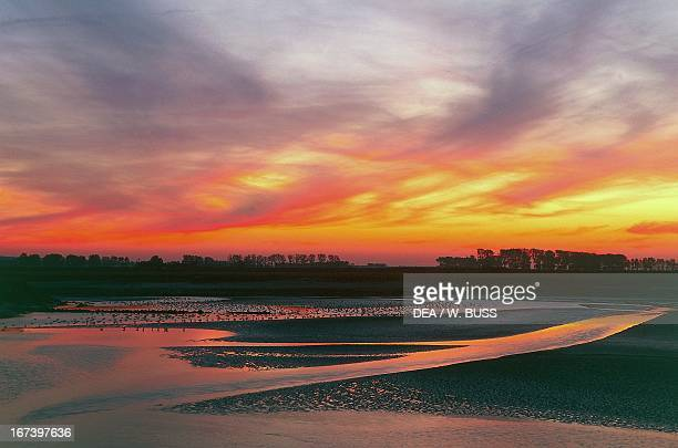 Bay at sunset near MontSaintMichel Lower Normandy France