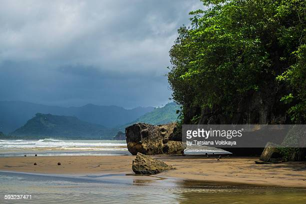 bay between the mountains and rocks - east java province stock photos and pictures