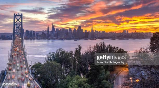 bay bridge and san francisco skyline - bay bridge stock pictures, royalty-free photos & images