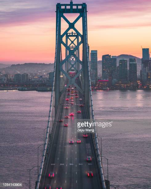 bay bridge golden hour - golden hour stock pictures, royalty-free photos & images