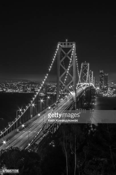 bay bridge illuminated by night, san francisco, california, usa - bay bridge stock pictures, royalty-free photos & images