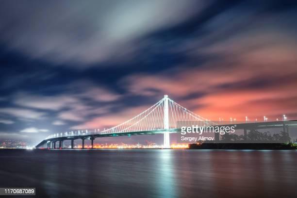 bay bridge night view, san francisco, california, us - treasure island california stock pictures, royalty-free photos & images
