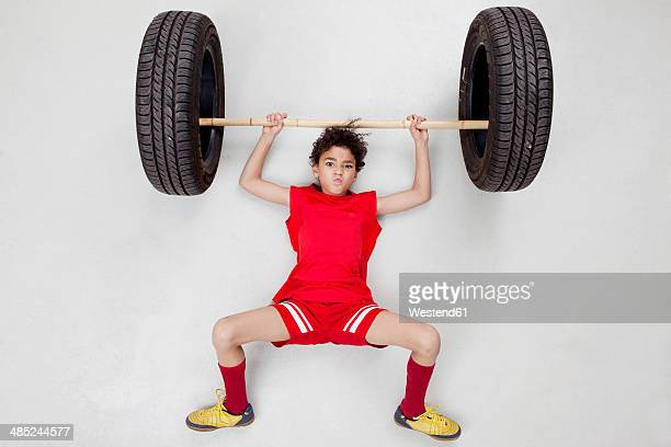 bay lifting weights - kids weightlifting ストックフォトと画像