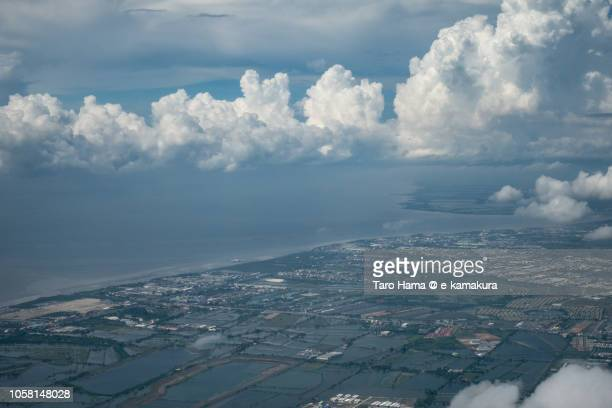 Bay of Bangkok and Samut Prakan province in Thailand daytime aerial view from airplane