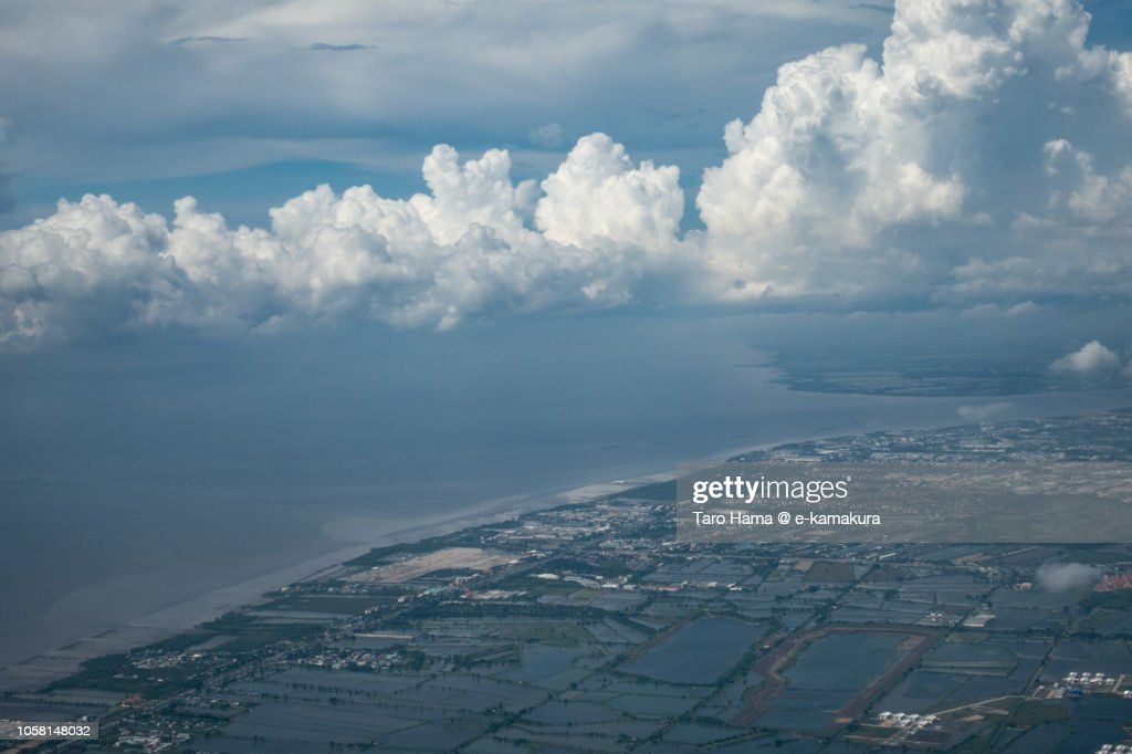 Bay of Bangkok and Samut Prakan province in Thailand daytime aerial view from airplane : Stock Photo