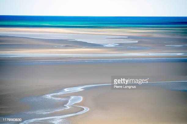 bay of mont-saint-michel at low tide open sea in backdrop - haute normandie stockfoto's en -beelden
