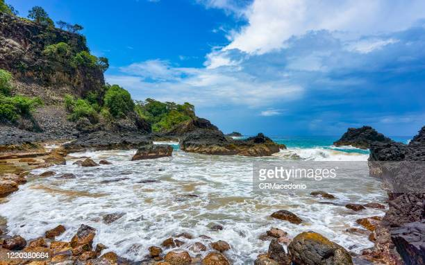 bay of pigs (baia dos porcos), in fernando de noronha. volcanic stones, crystal clear sea with various shades of green in the background, and natural pools carved in the rocks. - crmacedonio stock pictures, royalty-free photos & images