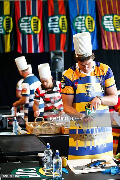 Bay of Plenty captain Culum Retallick cooks a burger on a BBQ during a hamburger competition for the ITM Cup season launch at Western Springs Stadium...