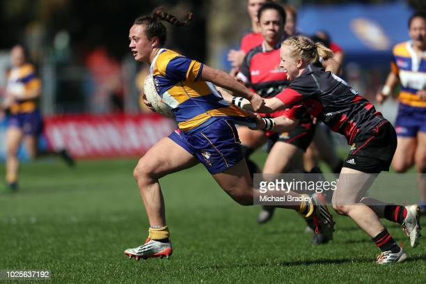 Bay of Plenty's Jade Tuilaepa looks to fend off Canterburys Kendra Cocksedge during the round one Farah Palmer Cup match between Bay of Plenty and...