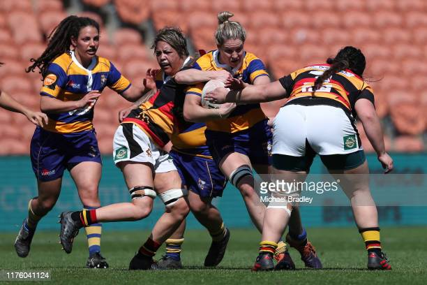 Bay of Plenty's Kelsie Wills is tackled by the defense during the round 4 Farah Palmer Cup match between Waikato and Bay of Plenty at FMG Stadium on...