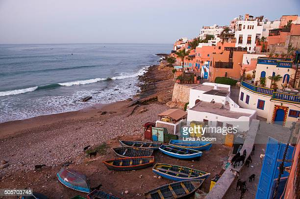 bay of taghazout with boats and goats - agadir stock pictures, royalty-free photos & images