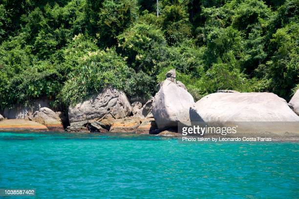 bay of water at paraty - leonardo costa farias stock photos and pictures