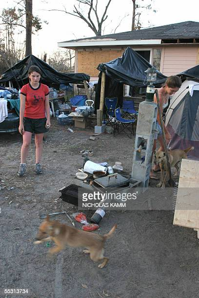 Amanda Bufkin and her sister Helen stand in the camp they have set up in front of their damaged house where they live with their mother and brother...