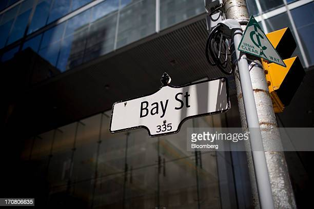 A Bay Street sign hangs from a post in Toronto Ontario Canada on Monday June 17 2013 The Canadian dollar declined for a third day versus its US peer...
