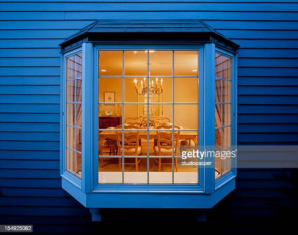 bay window of dinning room seen from outside - erker stockfoto's en -beelden