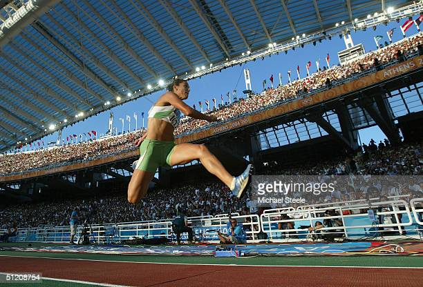 Baya Rahouli of Algeria competes in the women's triple jump final on August 23 2004 during the Athens 2004 Summer Olympic Games at the Olympic...