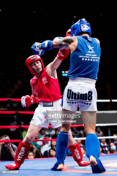 Bayadaa Mendbayar of Mongolia fights against Wong Kim Nam of Hong Kong in the male muay 60KG division weight bout during the East Asian Muaythai...