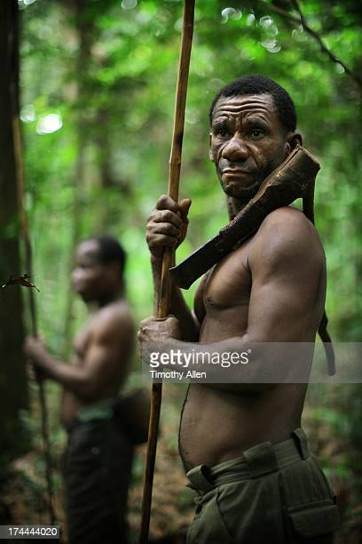 Bayaka tribesman holding spear and primitive axe