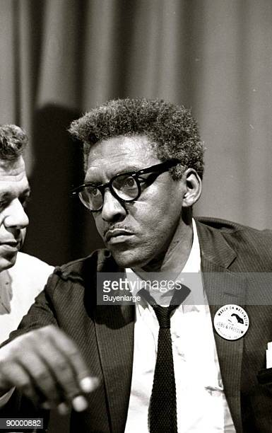 Bayard Rustin at news briefing on the Civil Rights March on Washington in the Statler Hotel halflength portrait seated at table