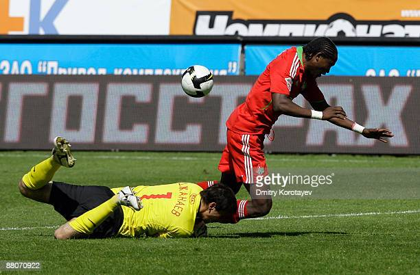 Baye Djiby Fall of FC Lokomotiv Moscow battles for the ball with Soslan Djanaev of FC Spartak Moscow during the Russian Football League Championship...