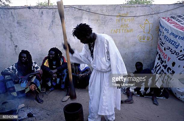 Baye Fall members prepare Touba coffee in the garden of Sheikh Ndigal Fall's house during the pilgrimage of the Magal De Touba April 23 2003 in Touba...
