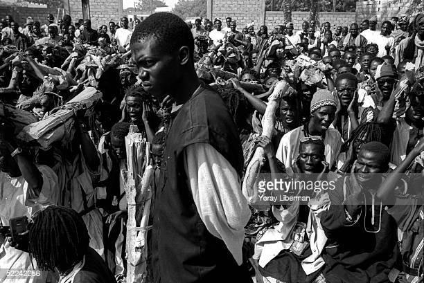 Baye Fall practice traditional rituals in Mbake during the Magal De Touba April 23 2003 in Mbake Senegal The Mouride Baye Fall community in Senegal...