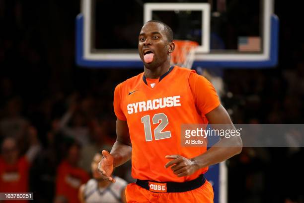 Baye Keita of the Syracuse Orange reacts in overtime against the Georgetown Hoyas during the semifinals of the Big East Men's Basketball Tournament...
