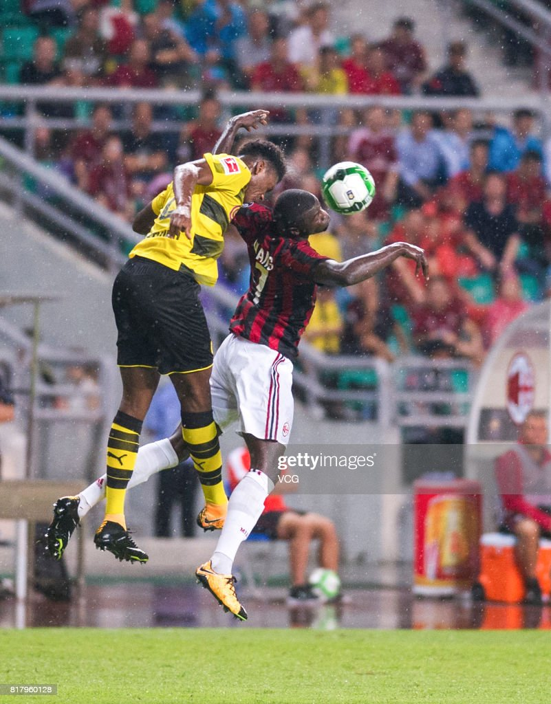 M'Baye Niang #7 of AC Milan and Dan-Axel Zagadou #2 of Borussia Dortmund compete for the ball during the 2017 International Champions Cup China between AC Milan and Borussia Dortmund at University Town Sports Centre Stadium on July 18, 2017 in Guangzhou, China.