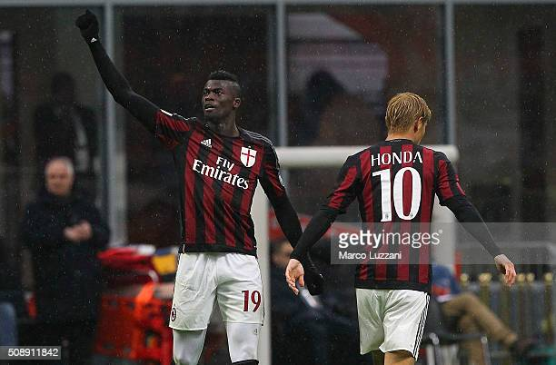 Baye Niang of AC Milan celebrates his goal with his teammate Keisuke Honda during the Serie A match between AC Milan and Udinese Calcio at Stadio...
