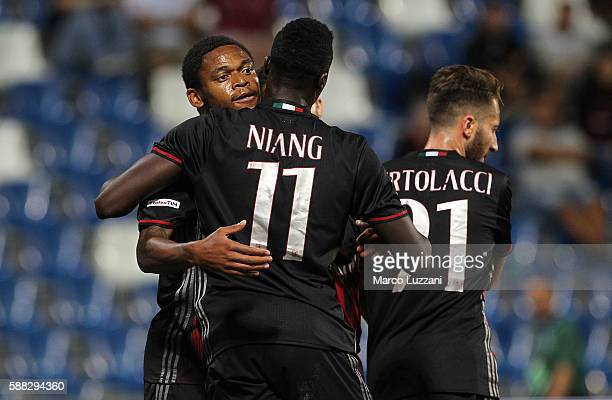 M' Baye Niang of AC Milan celebrates his goal with his teammate Luiz Adriano during the TIM Preseason Tournament at Mapei Stadium Citta' del...