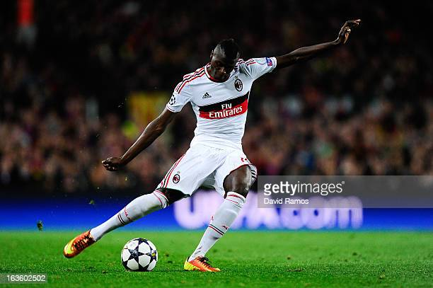 Baye Niang of AC Milan passes the ball during the UEFA Champions League round of 16 second leg match between FC Barcelona and AC Milan at the Camp...