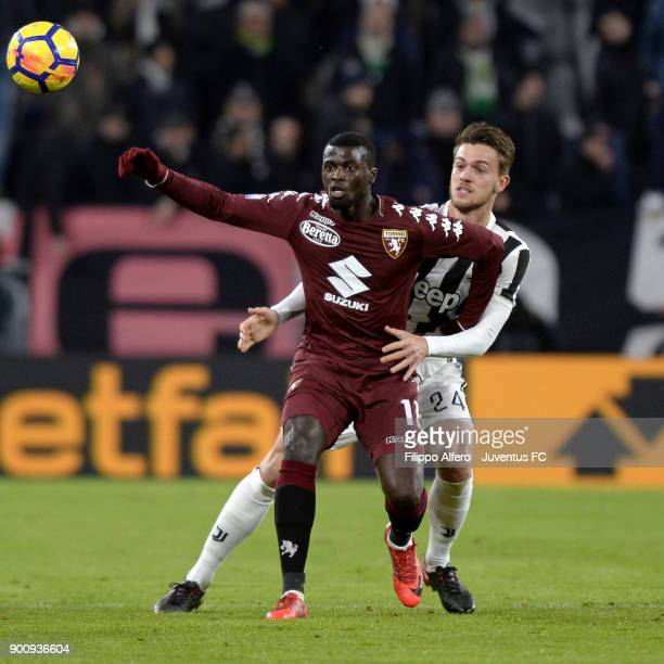 Baye Niang of Torino competes for the ball with Daniele Rugani of Juventus during the TIM Cup match between Juventus and Torino FC at Allianz Stadium...