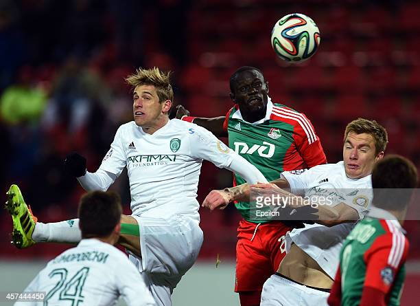 Baye Oumar Niasse of FC Lokomotiv Moscow is challenged by Adilson and Andrei Semyonov of FC Terek Grozny during the Russian Premier League match...