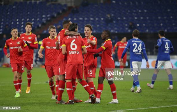 Bayer 04 Lerverkusen players celebrate after their first goal which was an own goal scored by Malick Thiaw of FC Schalke 04 during the Bundesliga...