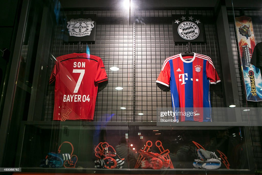 Bayer 04 Leverkusen and FC Bayern Munich soccer jerseys hang on display at the reception area of Nexon Co. e-Sports Stadium prior to the final round of the Electronic Arts Inc. (EA) Sports FIFA Online Championship at the Nexon Co. e-Sports Stadium in Seoul, South Korea, on Saturday, Oct. 17, 2015. Video game competitions, known as eSports, have been expanding as gamers seek to shift perceptions around their craft from a basement hobby to a serious money making industry. Photographer: Jean Chung/Bloomberg via Getty ImagesFC