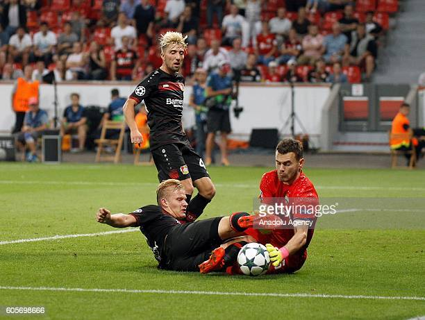 Bayer 04 Leverkusen's Joel Pohjanpalo and PFC CSKA Moscow's Igor Akinfeev in action during their UEFA Champions League group E soccer match between...