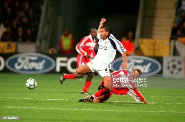 Bayer 04 Leverkusen's Ulf Kirsten is tackled by Spartak Moscow's Dmitry Parfenov