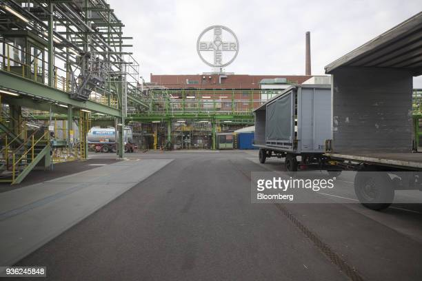 A Bayer AG logo sits above the Bayer CropScience AG crop protection production site in Dormagen Germany on Wednesday March 21 2018 Bayer cleared one...