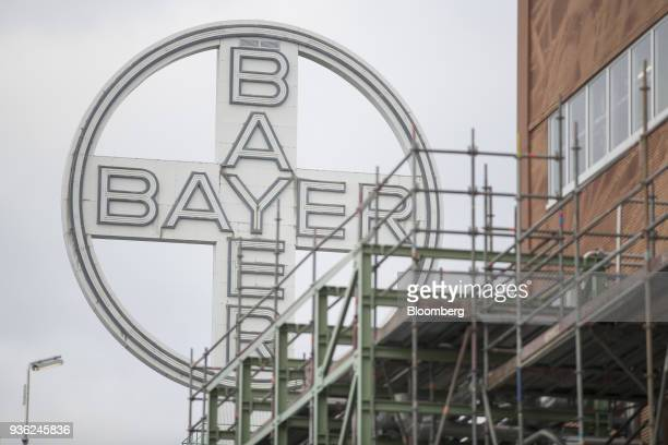 A Bayer AG logo sits at the Bayer CropScience AG crop protection production site in Dormagen Germany on Wednesday March 21 2018 Bayer cleared one big...