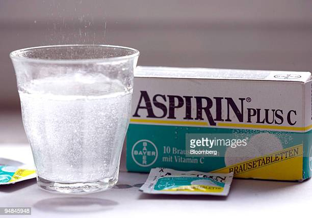 Bayer aspirin tablets dissolve in a glass in Bonn Germany on Wednesday Sept 17 2008 Speculation continues that Pfizer Inc will bid for the company