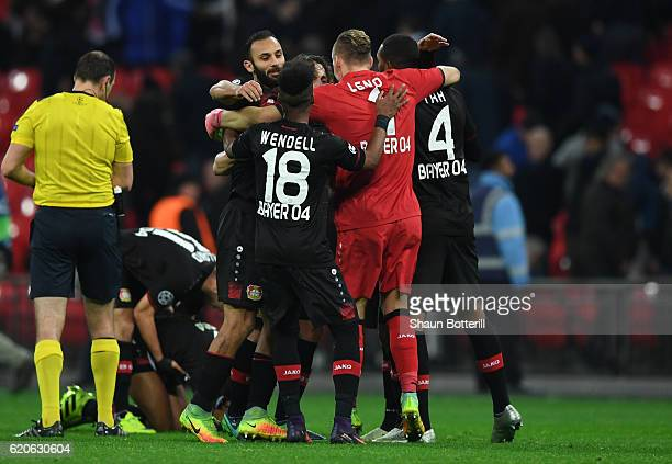 Bayer Leverkusen players celebrate victory after the full time whistle during the UEFA Champions League Group E match between Tottenham Hotspur FC...